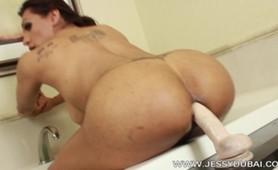 Jessy fucks a big dildo in bathroom